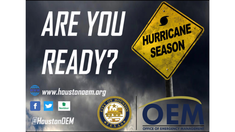 Text: Are you ready? Graphic: Dark clouds and a yellow traffic sign with hurricane season on it.